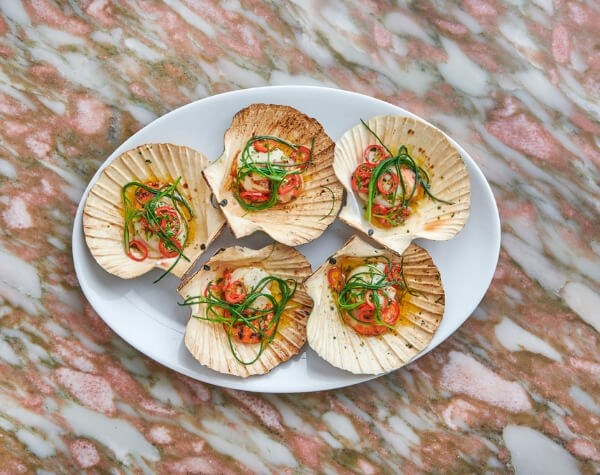 The Scallops are available at Daphne's, a romantic restaurant in Kensington
